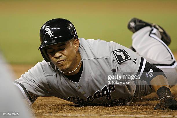Chicago's Alex Cintron dives back into first base during action between the Chicago White Sox and Kansas City Royals at Kauffman Stadium in Kansas...