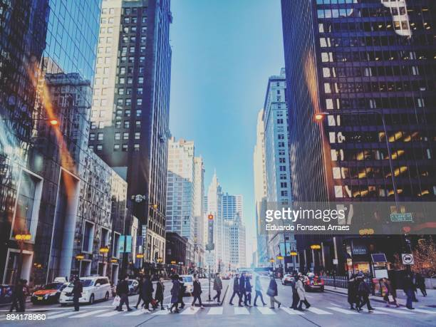 chicago's busy downtown - pedestrian crossing stock photos and pictures