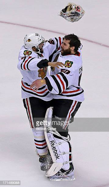 Chicago's Johnny Oduya leaps into the arms of goalie Corey Crawford following their victory The Boston Bruins hosted the Chicago Blackhawks for Game...