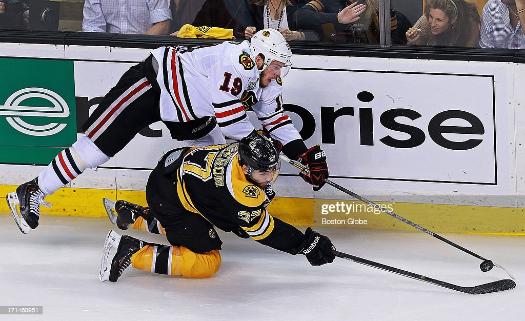 Chicago's Jonathan Toews and the Bruins Patrice Bergeron battle in the second period. The Boston Bruins hosted the Chicago Blackhawks for Game Six of the Stanley Cup Finals at TD Garden, June 24, 2013.