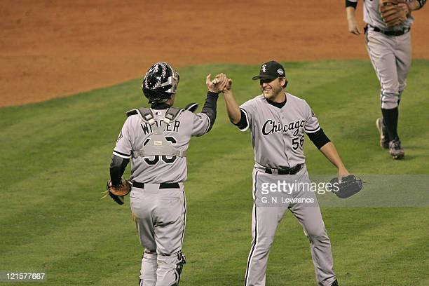 Chicago's Mark Buehrle celebrates with catcher Chris Widger after winning game 3 of the World Series between the Chicago White Sox and the Houston...