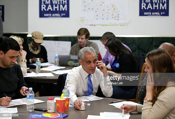 Chicago's mayor and candidate for reelection Rahm Emanuel center calla a voter on a mobile phone to remind them to vote during the election as he...