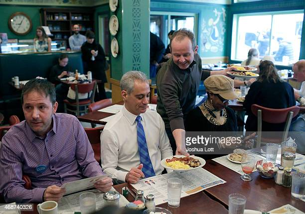 Chicago's mayor and candidate for reelection Rahm Emanuel is served breakfast at Ann Sather's with his campaign workers April 6 2015 in Chicago...