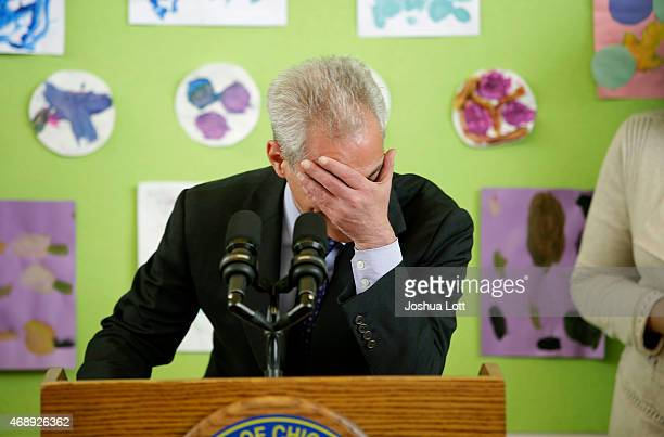 Chicago's Mayor Rahm Emanuel places his hand over his face as he laughs at his own joke during a news conference at Carole Robertson Center for...