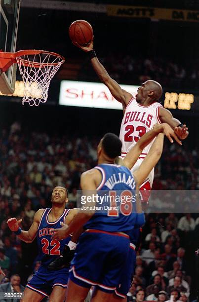 Chicago''s Michael Jordan rises above Cavaliers Larry Nance and John Wiliams during the Bulls'' 9184 victory in the second round of the 1993 NBA...