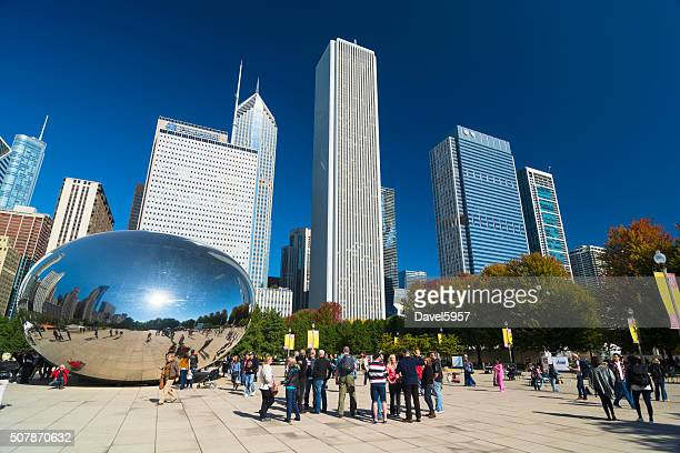 chicago's millenium park with skyscrapers and cloud gate - millenium park stock photos and pictures