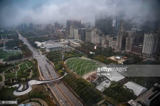 chicago's millennium park under clouds - ken ilio stock pictures, royalty-free photos & images