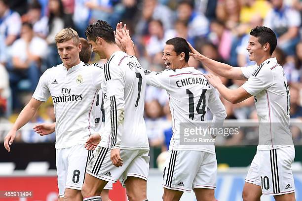 Chicharito Hernandez of Real Madrid CF celebrates with his teammates after scoring his team's seventh goal during the La Liga match between RC...