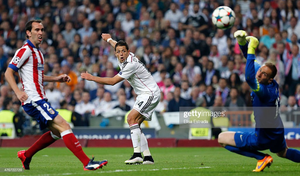 Chicharito Hernandez of Real Madrid shoots on goal during the UEFA Champions League Quarter Final second leg match between Real Madrid CF and Club Atletico de Madrid at Estadio Santiago Bernabeu on April 22, 2015 in Madrid, Spain.
