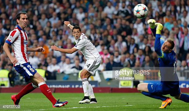 Chicharito Hernandez of Real Madrid shoots on goal during the UEFA Champions League Quarter Final second leg match between Real Madrid CF and Club...