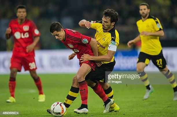 Chicharito of Bayer 04 Leverkusen Mats Hummels of Borussia Dortmund during the Bundesliga match between Borussia Dortmund and Bayer 04 Leverkusen on...
