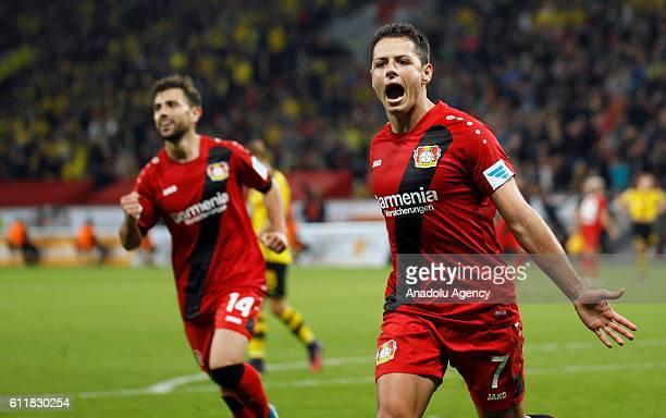 Chicharito of Bayer Leverkusen celebrates after scoring a goal during the Bundesliga soccer match between Borussia Dortmund and Bayer Leverkusen at...