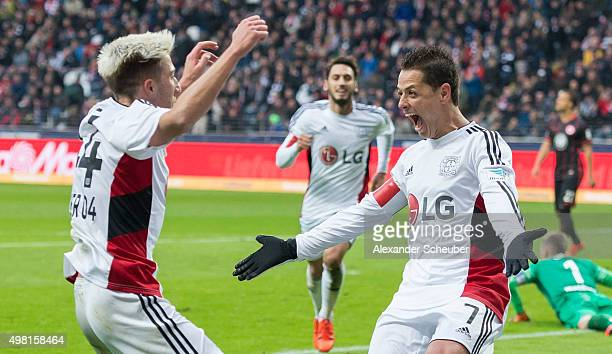 Chicharito of Bayer Leverkusen celebrates the first goal for his team with Hakan Calhanoglu of Bayer Leverkusen and Kevin Kampl of Bayer Leverkusen...