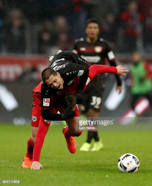 Chicharito of Bayer Leverkusen is challenged by Bastian Oczipka of Frankfurt during the Bundesliga match between Bayer 04 Leverkusen and Eintracht...