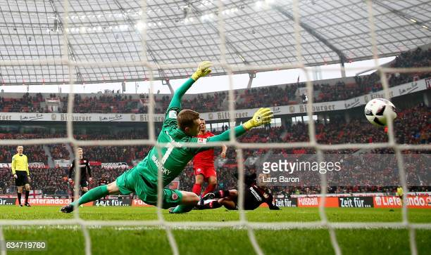 Chicharito of Bayer Leverkusen scores his teams first goal during the Bundesliga match between Bayer 04 Leverkusen and Eintracht Frankfurt at...