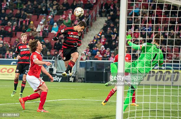 Chicharito of Bayer Leverkusen scores the first goal for his team against Loris Karius of 1 FSV Mainz 05 during the first bundesliga match between 1...
