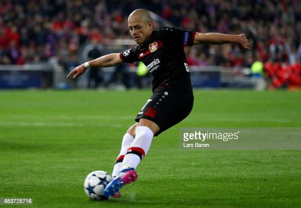 Chicharito of Bayer Leverkusen shoots on goal during the UEFA Champions League Round of 16 second leg match between Club Atletico de Madrid and Bayer...
