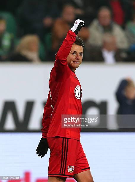 Chicharito of Leverkusen celebrates after scoring his team's first goal during the Bundesliga match between VfL Wolfsburg and Bayer Leverkusen at...