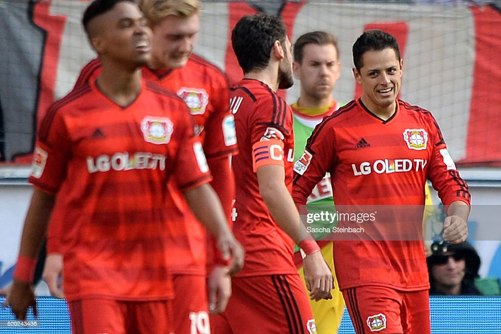 Chicharito (R) of Leverkusen celebrates with team mates after scoring his team's second goal during the Bundesliga match between 1. FC Koeln and Bayer Leverkusen at RheinEnergieStadion on April 10, 2016 in Cologne, Germany.