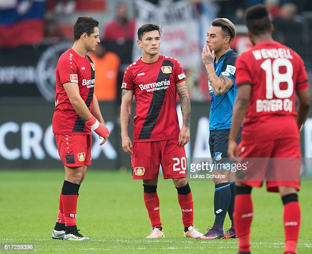 Chicharito of Leverkusen Charles Aranguiz of Leverkusen and Eduardo Vargas of Hoffenheim stand together after the Bundesliga match between Bayer 04...