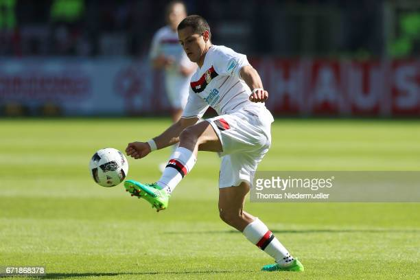 Chicharito of Leverkusen in action with the ball during the Bundesliga match between SC Freiburg and Bayer 04 Leverkusen at SchwarzwaldStadion on...