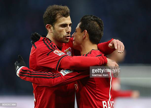 Chicharito of Leverkusen jubilates with team mate Admir Mehmedi after scoring the second goal during the Bundesliga match between Hertha BSC and...