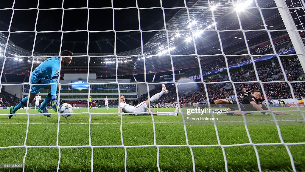 Chicharito of Leverkusen (R) scores a disallowed goal against goalkeeper Hugo Lloris of Tottenham during the UEFA Champions League match between Bayer 04 Leverkusen and Tottenham Hotspur FC at BayArena on October 18, 2016 in Leverkusen, North Rhine-Westphalia.