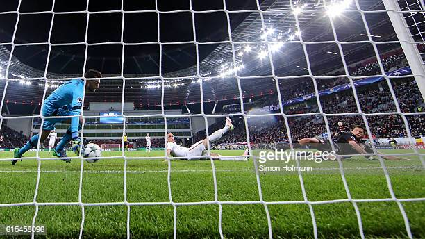 Chicharito of Leverkusen scores a disallowed goal against goalkeeper Hugo Lloris of Tottenham during the UEFA Champions League match between Bayer 04...