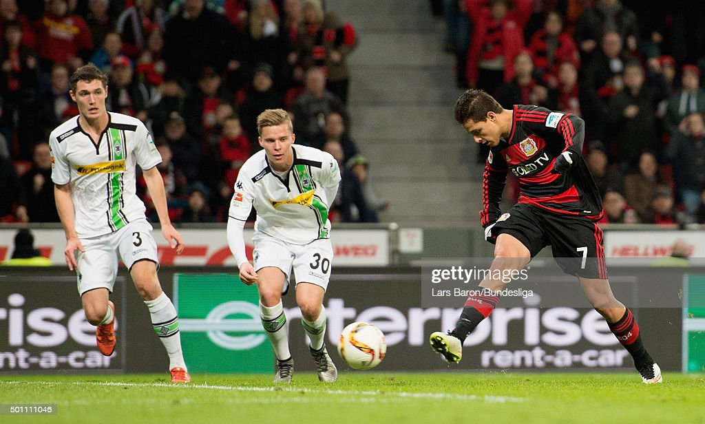 Chicharito of Leverkusen scores his teams second goal during the Bundesliga match between Bayer Leverkusen and Borussia Moenchengladbach at BayArena on December 12, 2015 in Leverkusen, Germany.