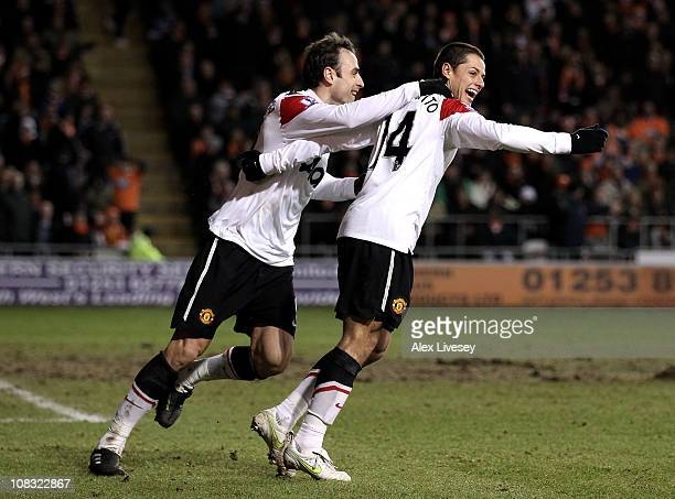 Chicharito of Manchester United celebrates scoring his team's second goal with team mate Dimitar Berbatov during the Barclays Premier League match...