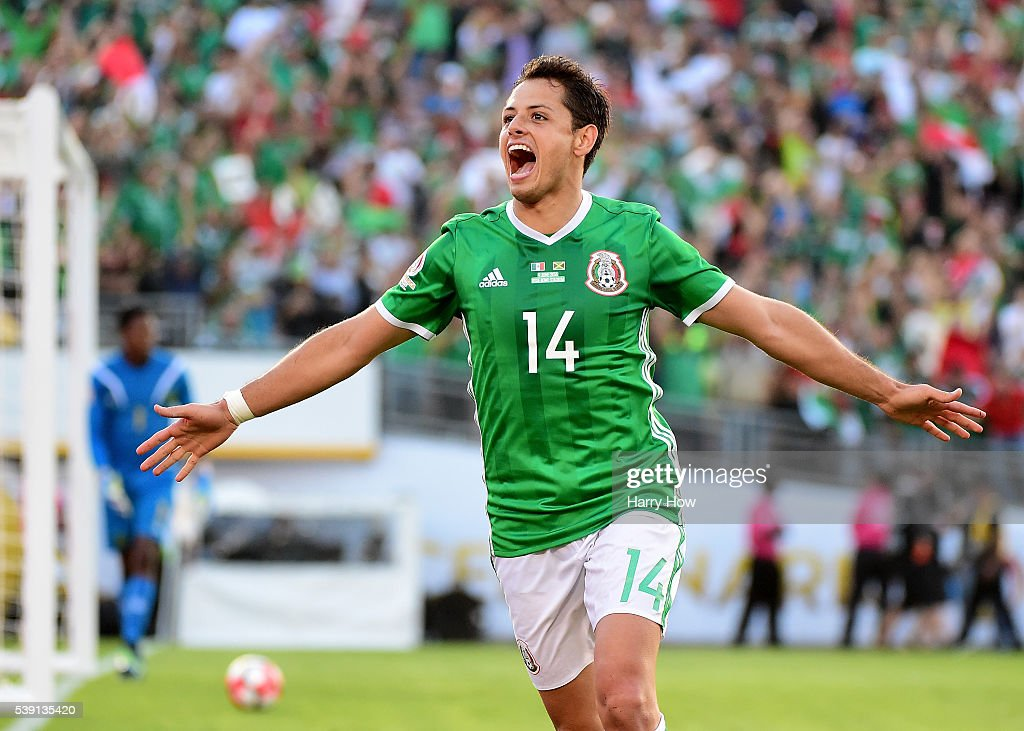 Chicharito #14 of Mexico celebrates after his goal in front of Andre Blake #1 of Jamaica to take a 1-0 lead during Copa America Centenario at the Rose Bowl on June 9, 2016 in Pasadena, California.