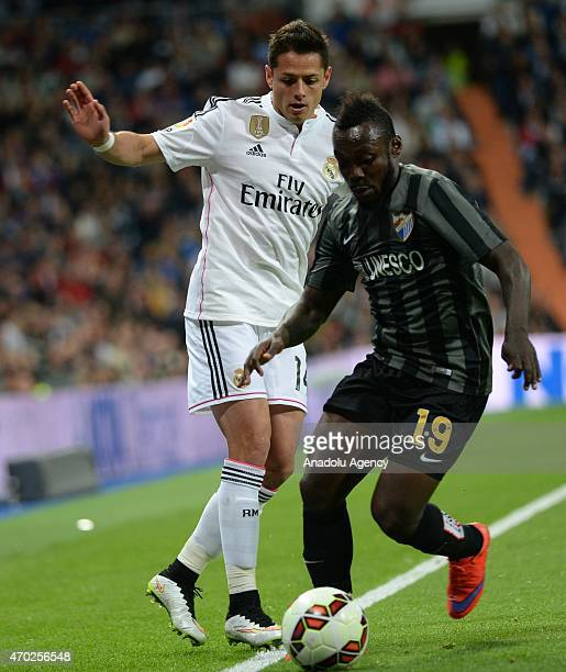 Chicharito of Real Madrid is in action against Boka i of Malaga during the La Liga match between Real Madrid and Malaga at Estadio Santiago Bernabeu...
