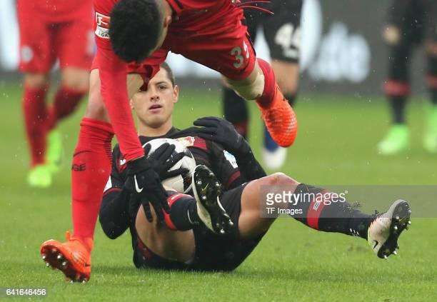 Chicharito und Omar Mascarell of Eintracht Frankfurt battle for the ball during the Bundesliga match between Bayer 04 Leverkusen and Eintracht...