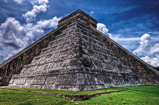 Chichen Itza Pyramid with a blue sky.