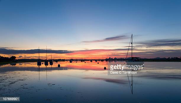 chichester harbour at dusk, bosham, england - west sussex stock pictures, royalty-free photos & images