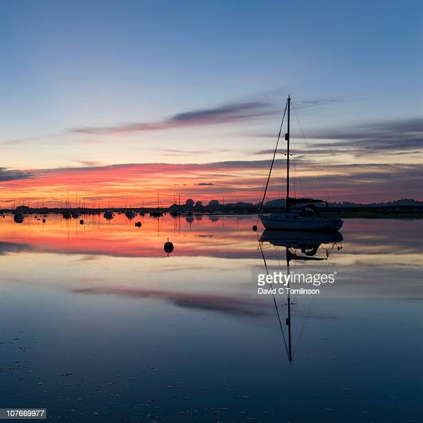 chichester harbour at dusk, bosham, england - chichester stock pictures, royalty-free photos & images
