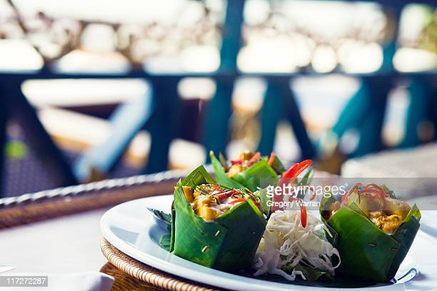 chicken amok - traditionally cambodian stock pictures, royalty-free photos & images