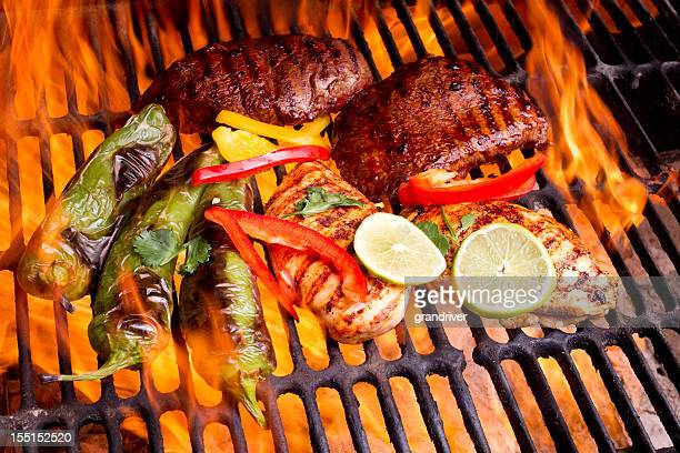 Chicken and Beef Fajitas with flames