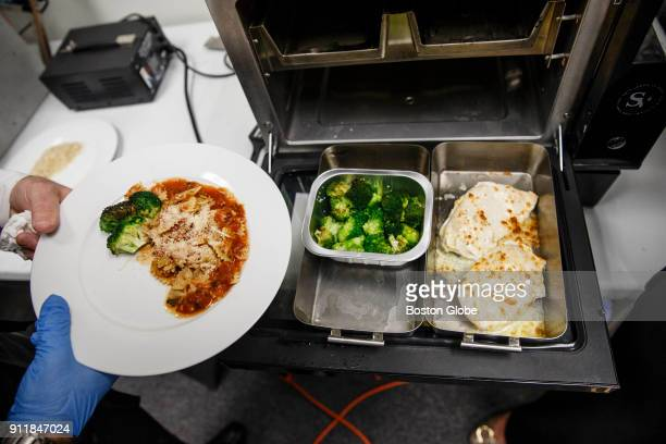 Chicken and broccoli roasted in the Suvie a sous vide cooking device is puled from a unit at the company's office in Cambridge MA on Jan 23 2018...