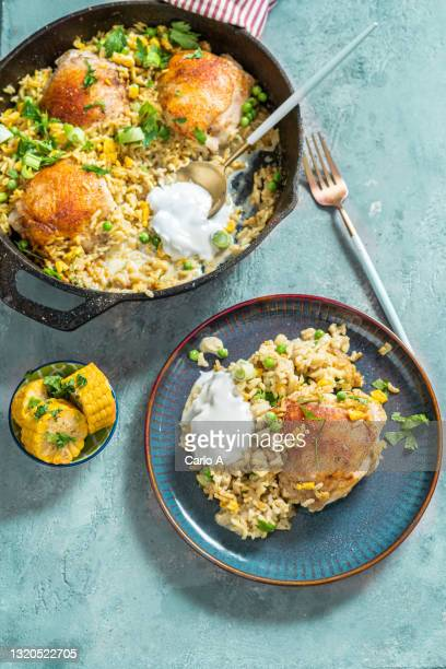 chicken and curry rice in a skillet - tikka masala stock pictures, royalty-free photos & images
