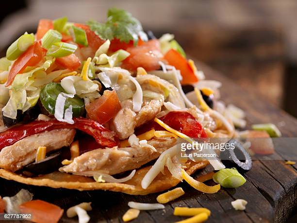 chicken and pepper tostada - nachos stock photos and pictures
