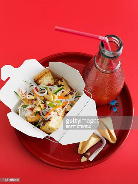 Chicken and vegetables in take out box