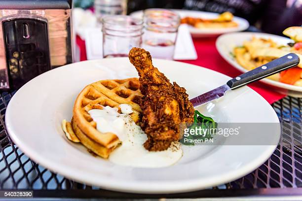 chicken and waffle - chicken and waffles stock photos and pictures