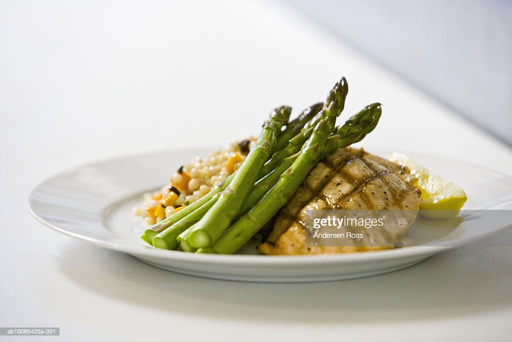 Chicken, asparegus and rice pilaf on plate : Foto stock