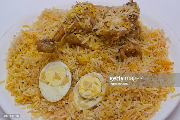 Chicken Biryani With Boiled Egg Served In Plate
