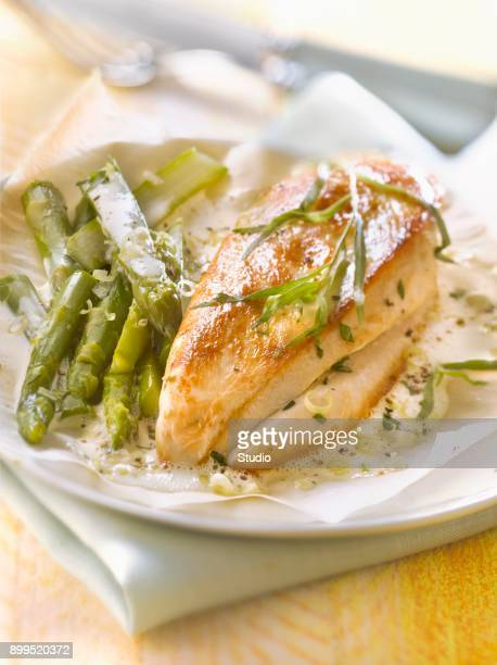 Chicken breast and green asparagus cooked in wax paper with foamy tarragon and citronella sauce