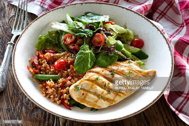 chicken breast with bulgur tabbouleh and green salad - food state stock pictures, royalty-free photos & images