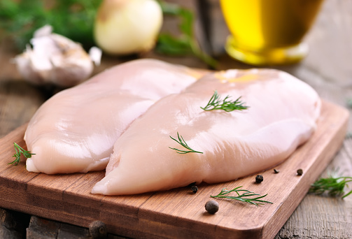 Chicken breasts on cutting board 492787098