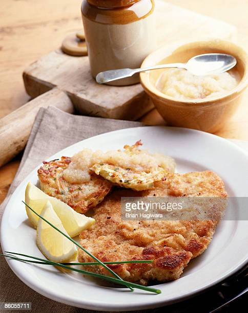 chicken cutlet milanese with potato pancakes - milanese stock pictures, royalty-free photos & images