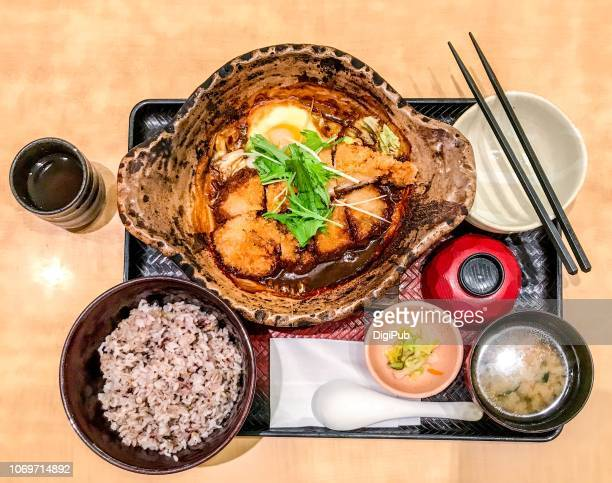 chicken cutlet stew in miso with five cereal grain rice lunch meal on table - washoku fotografías e imágenes de stock